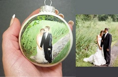 "This is a lovely portrait of the Bride and Groom hand painted onto a Christmas Ornament from their wedding photos.  The ornament is 2 5/8"".  That's pretty small!  We capture the essence of the moment making this a treasured heirloom.  Personalized scripture on back with names, date and location included."