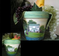 "Homes painted on clay pots make wonderful ""First or New Home"" gifts!  They can be filled with lots of things, from food & drink to plants & bath towels.  Another idea is to serve your favorite beverage with plastic ice cubes, which keeps things chilled.  Send in your photos today.  Name, address, date, etc may be included.  Prices vary according to size of home and text.  This price reflects this home with yard and lake going all the way around."